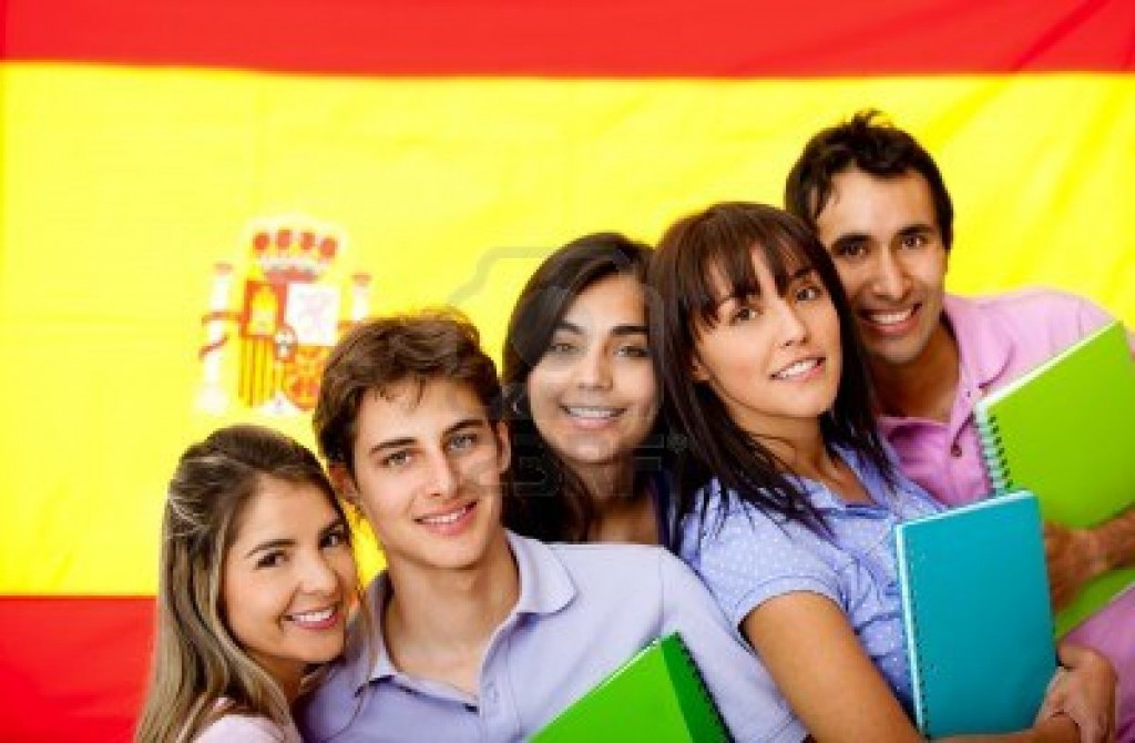 11465754-spanish-students-with-the-flag-of-spain-at-the-background